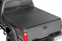 Exterior - Accessories - Rough Country - Rough Country Ford Hard Tri-Fold Bed Cover (99-16 F-250/350 - 6.5' Bed w/o Cargo Mgmt) 45599650